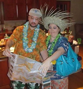 couple dressed for beach planning vacation