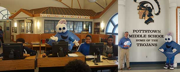 (L) Chip takes part in a computer class at the Pottstown Middle School library. (R) Rob Hackash, Marketing Manager for Diamond Credit Union, displays several handmade thank you cards from the students, with Chip, inside the school. Photos by Anthony Hoey.